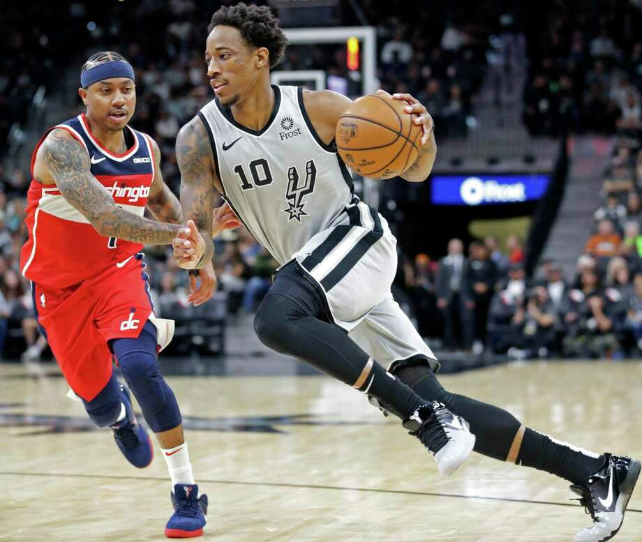 DeMar DeRozan heads to the lane on Isaiah Thomas as the Spurs host the Wizards at the AT&T Center on 26, 2019. Photo: Tom Reel, Staff / Staff Photographer / 2019 SAN ANTONIO EXPRESS-NEWS
