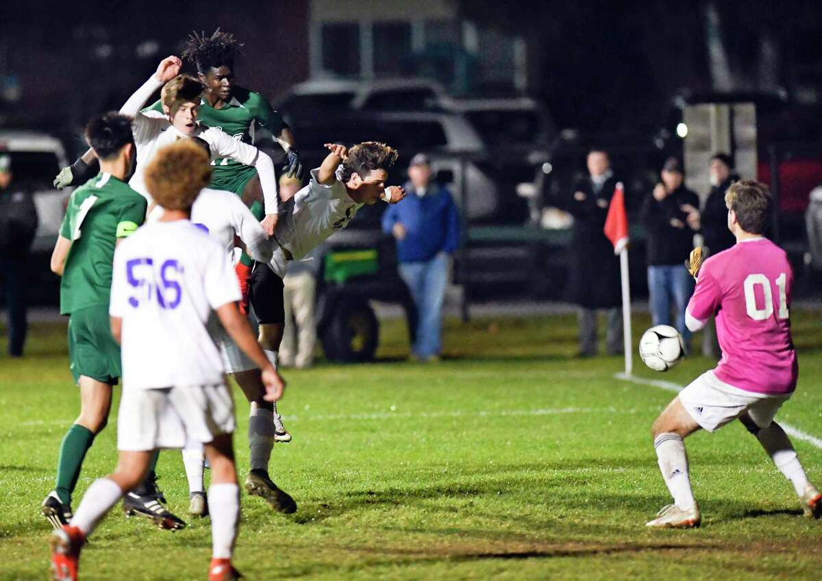 Shenendehowa's Toba Akinyemi, top left, heads the ball for a goal against Ballston Spa's goalkeeper Ethan Shuhart during a Section II Class AA boys' soccer quarterfinal game in Clifton Park, N.Y., Saturday, Oct. 26, 2019. (Hans Pennink / Special to the Times Union)