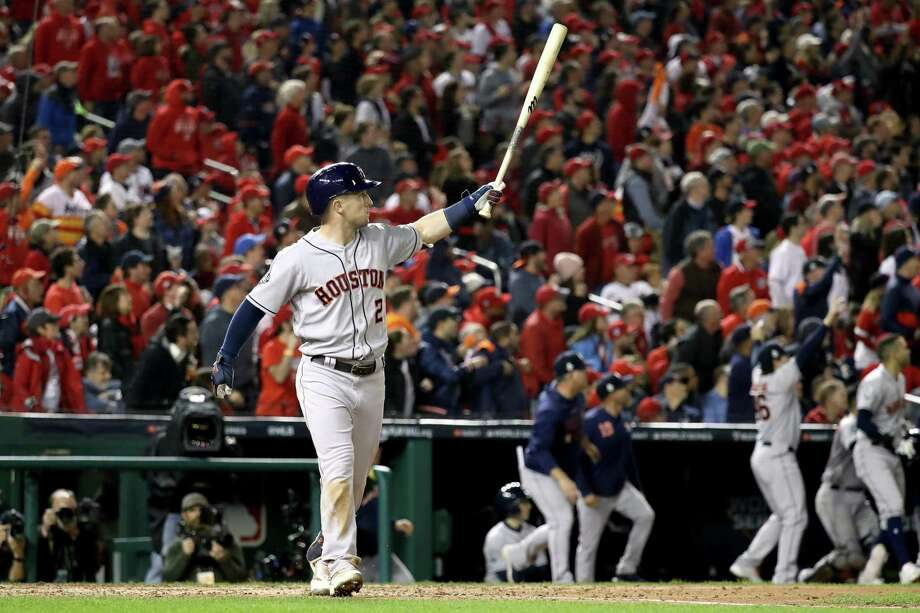 Alex Bregman (2) of the Houston Astros hits a grand slam home run against the Washington Nationals during the seventh inning in Game Four of the 2019 World Series at Nationals Park on Saturday in Washington, DC. Photo: Rob Carr, Staff / Getty Images / 2019 Getty Images