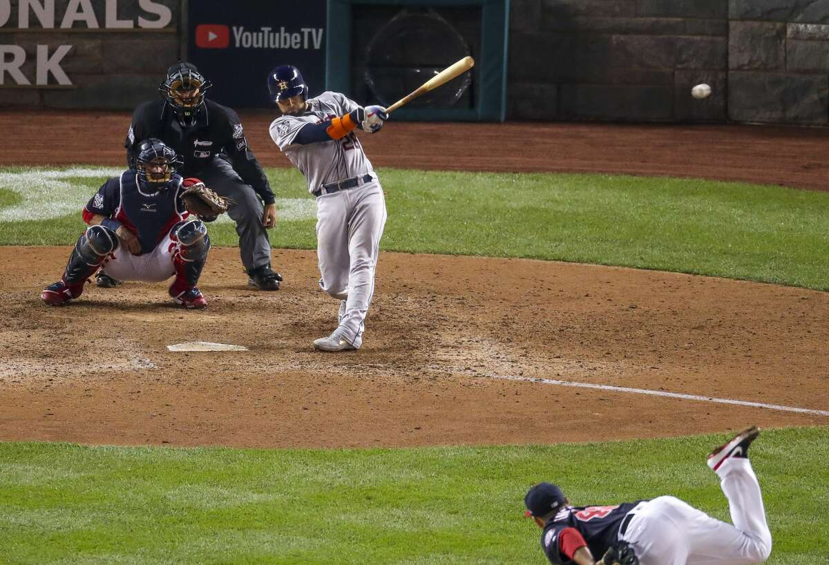 Houston Astros catcher Robinson Chirinos (28) hits a double to left field during the ninth inning of Game 4 of the World Series at Nationals Park in Washington, D.C. on Saturday, Oct. 26, 2019.
