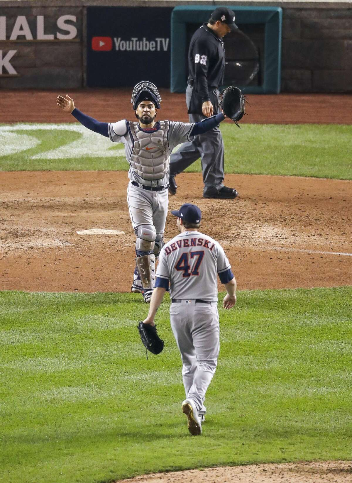 Houston Astros catcher Robinson Chirinos (28) celebrates with Houston Astros relief pitcher Chris Devenski (47) at the end of the ninth inning of Game 4 of the World Series at Nationals Park in Washington, D.C. on Saturday, Oct. 26, 2019.