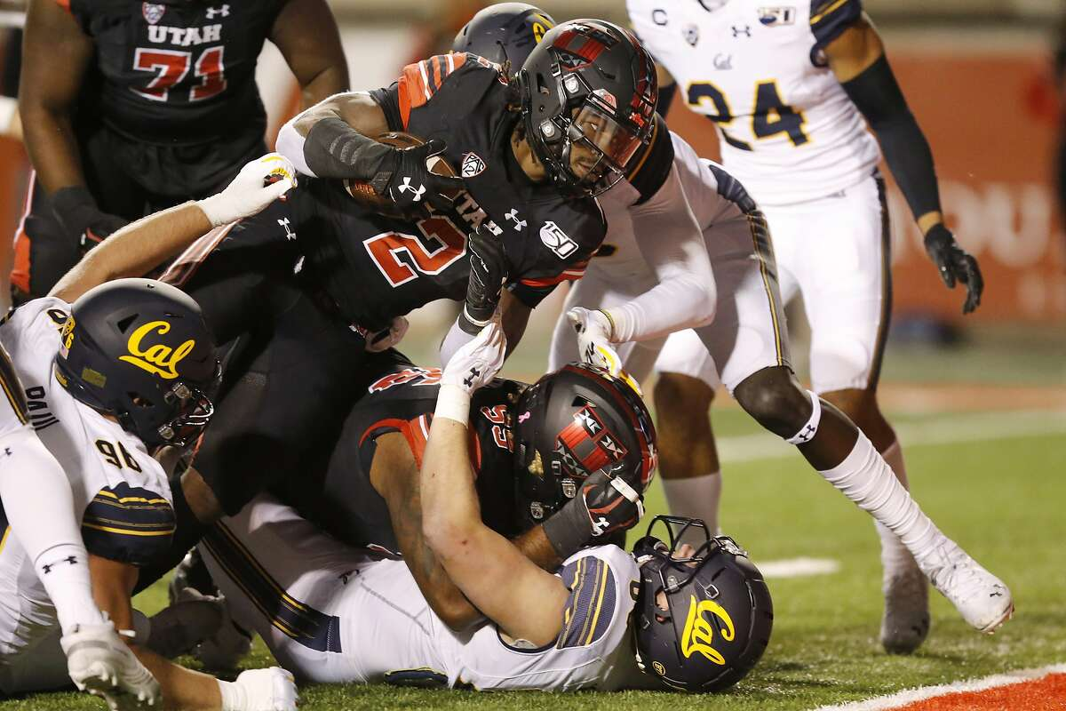 Utah's Zack Moss reaches the end zone while scoring one of his two touchdowns in his a win over Cal in Salt Lake City.