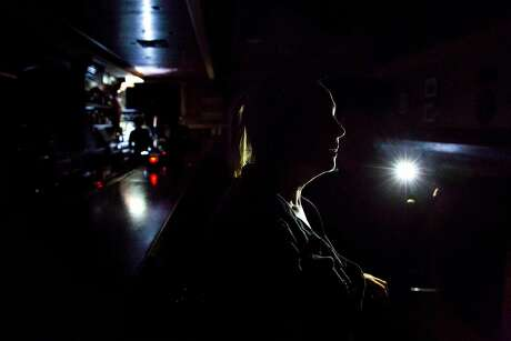 An employee is silhouetted by a flashlight at Finnigan's Marin Restaurant and Bar in Novato, Calif. during PG&E's Marin County power shut down on Saturday, Oct. 26, 2019. Residents throughout the North Bay are expected be without power starting Saturday evening as PG&E begins it's second Public Safety Power Shut-Off. PG&E states that over 940,000 residents will be without power through the weekend.