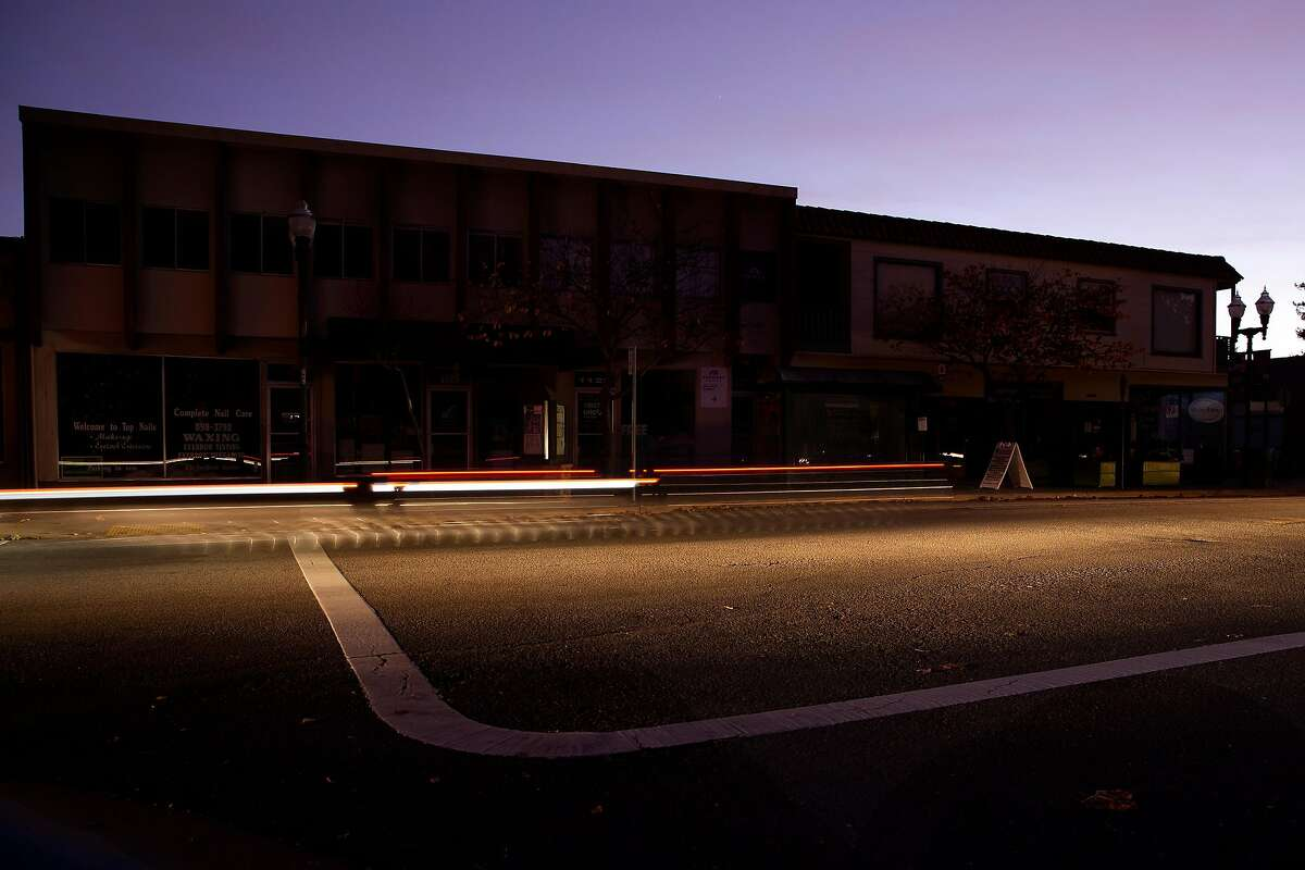 Cars drive through darkened streets in Novato, Calif. during PG&E's Marin County power shut down on Saturday, Oct. 26, 2019. Residents throughout the North Bay are expected be without power starting Saturday evening as PG&E begins it's second Public Safety Power Shut-Off. PG&E states that over 940,000 residents will be without power through the weekend.