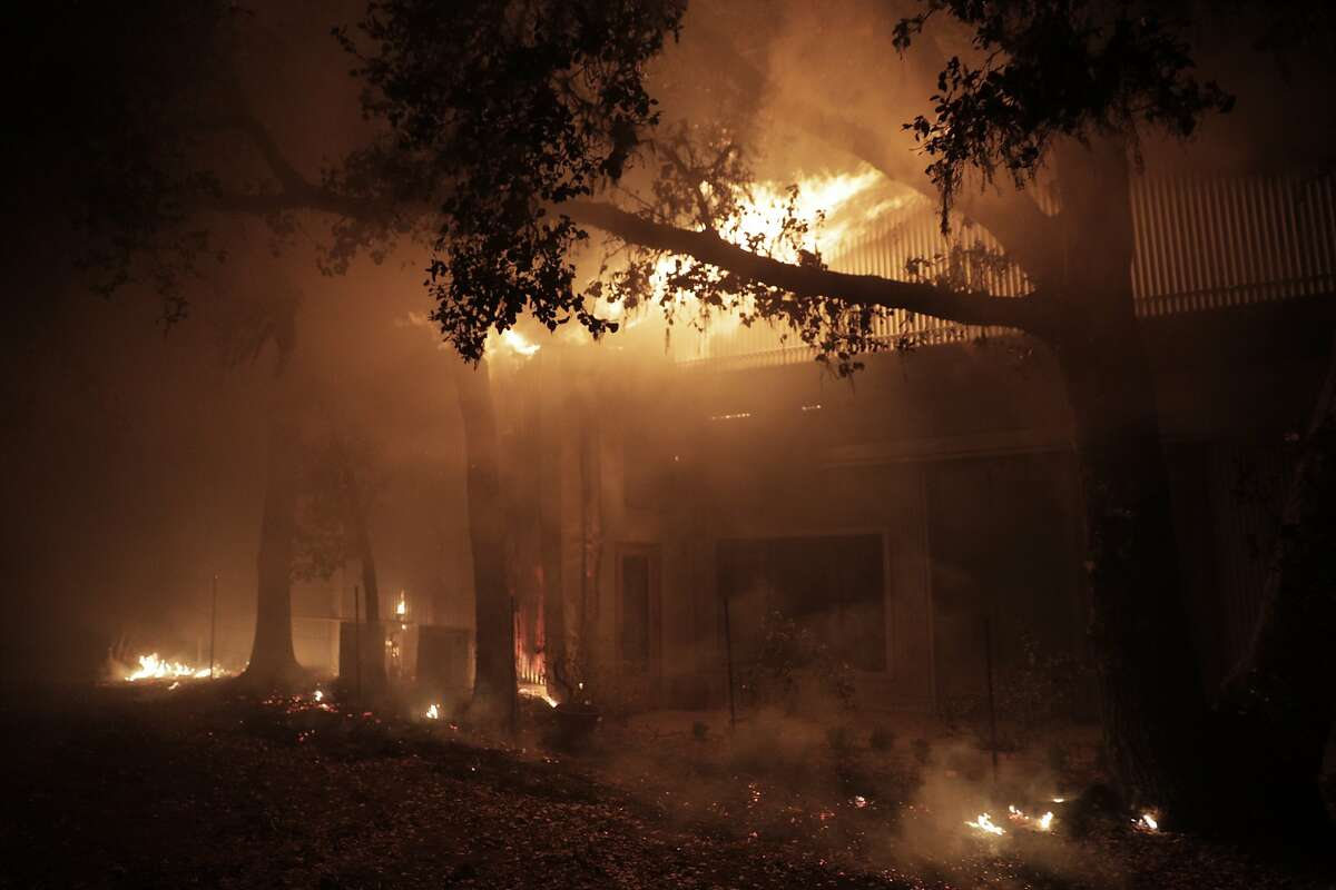A structure burns west of Highway 128 on Soda Rock Ln as the Kincade Fire continues to burn in Healdsburg, Calif., on Sunday, October 27, 2019.