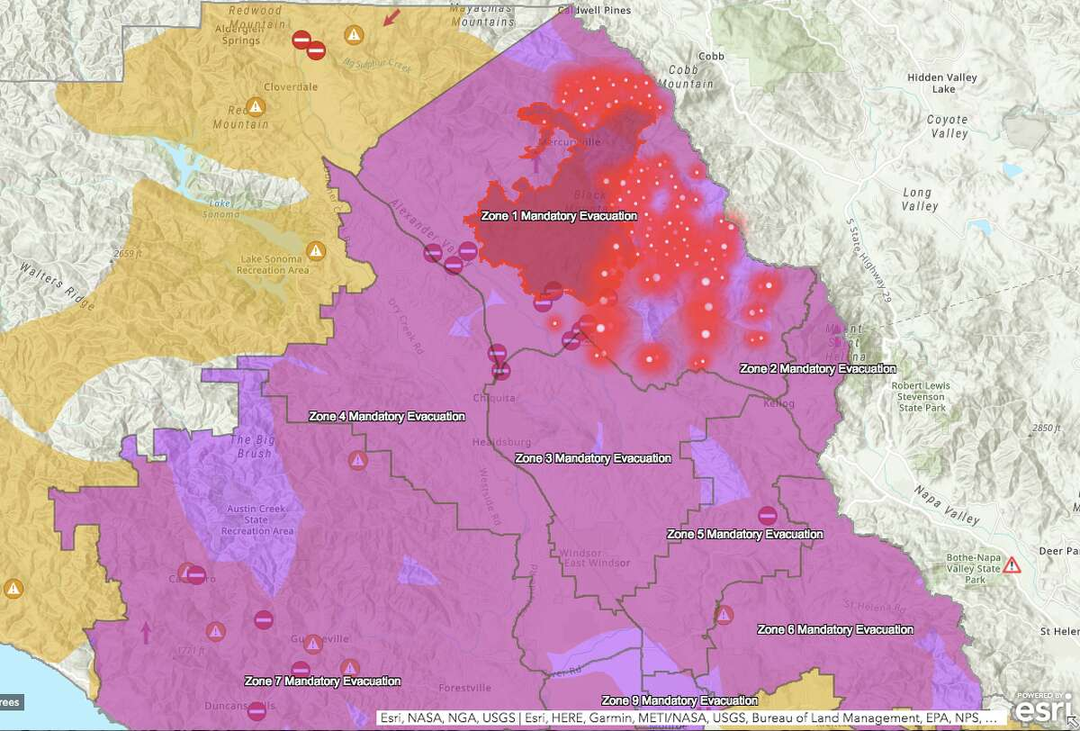 Sonoma County Incident map shows the Kincade Fire perimeter on Oct. 27, 2019. Red dots indicate where fires have been detected. Purple is the mandatory evacuation zone. Yellow is under a PG&E shutoff.