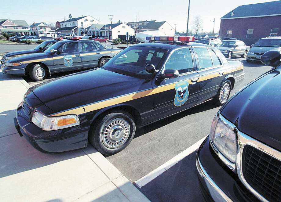 Police cruisers are parked at the Cromwell Police Dept. on Monday.................Tom Warren photo.........12/31/01.............MPcrom.jpg