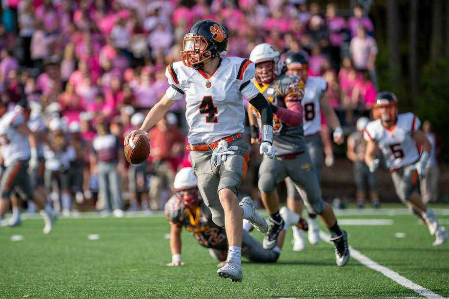Ridgefield quarterback Declan McNamara takes off on a run against St. Joseph Photo: David G. Whitham / For Hearst Connecticut Media