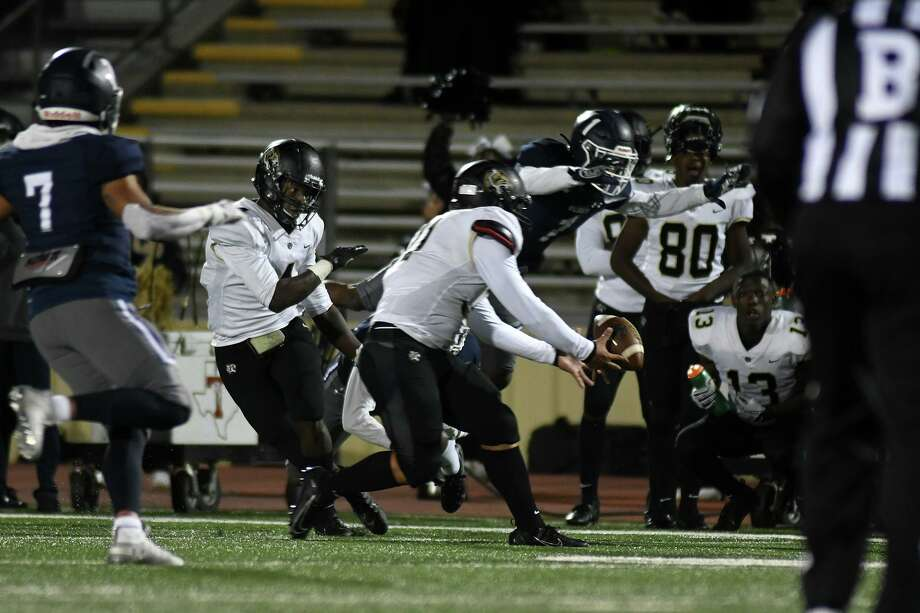 Cy Park's Omega Goodlette, center, catches a ball in mid-air after it was lost by Harold Perkins, left, on a pass play in the third quarter of their District 22-6A matchup at Turner Stadium in Humble on Oct. 25, 2019. Photo: Jerry Baker, Houston Chronicle / Contributor / Houston Chronicle
