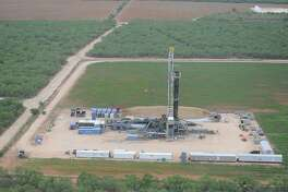 An aerial view shows drilling activity at a Carrizo Oil & Gas wells in northern LaSalle County.
