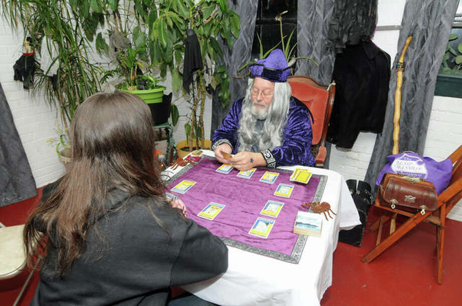 A Witches Night Out attendee gets a tarot card reading at Saturday night's event in the old Milton School in Alton. Organizers were pleased with the turnout for the premiere event and are planning an even larger one next year.