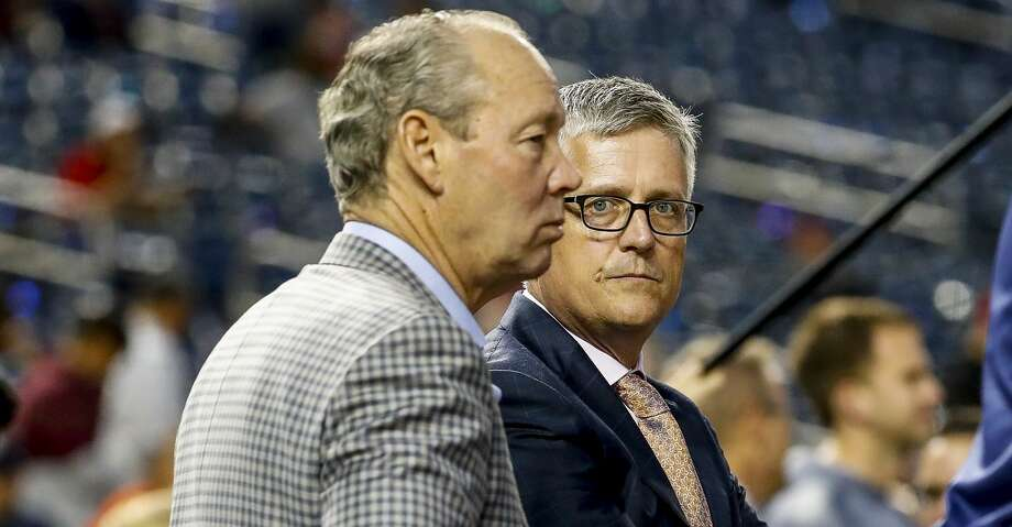 Astros owner Jim Crane and general manager Jeff Luhnow watch batting practice before Game 3 of the World Series at Nationals Park in Washington, D.C. on Friday, Oct. 25, 2019. Photo: Karen Warren/Staff Photographer