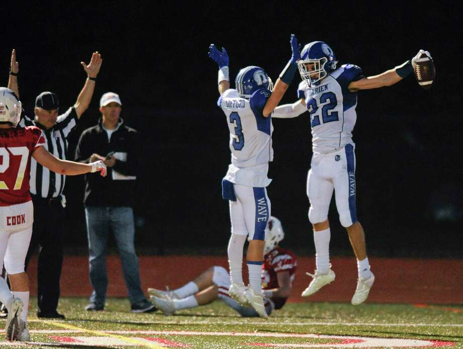 Darien's Jackson Peters (22) celebrates his game winning reception with Sean Gifford (3) against Greenwich in an FCIAC football game of unbeatens at Cardinal Stadium in Greenwich, Conn. on Oct. 26, 2019. Darien defeated Greenwich 27-21. Photo: Matthew Brown / Hearst Connecticut Media / Stamford Advocate