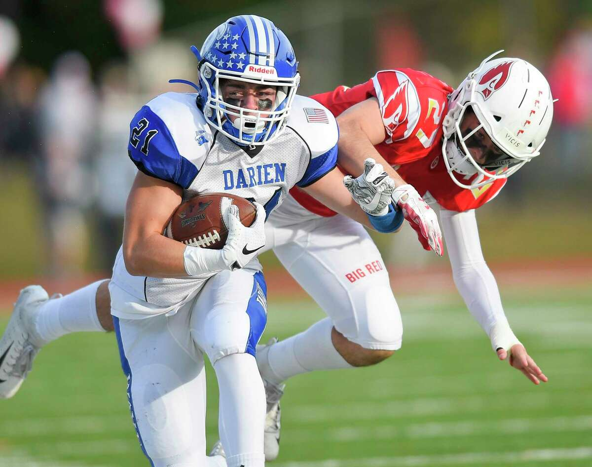 Darien's Will Kirby (21) carries the ball in the first half against Greenwich in an FCIAC football game of unbeatens at Cardinal Stadium in Greenwich, Conn. on Oct. 26, 2019. Darien defeated Greenwich 27-21.