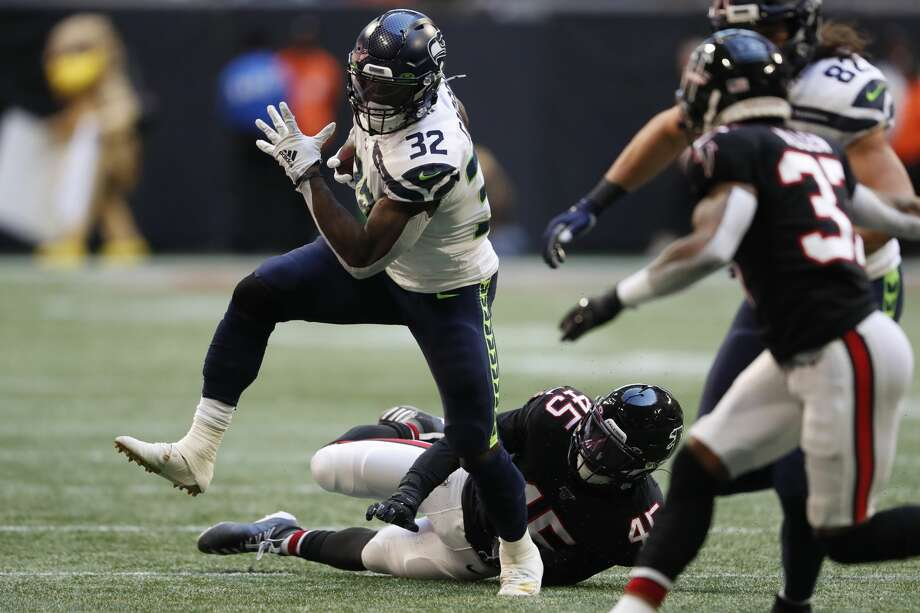 Seattle Seahawks running back Chris Carson (32) runs against Atlanta Falcons linebacker Deion Jones (45) during the first half of an NFL football game, Sunday, Oct. 27, 2019, in Atlanta. (AP Photo/John Bazemore) Photo: John Bazemore/AP