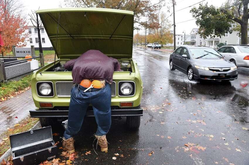 The Moxie bar and restaurant's entry in the Scarecrows Invade Madison contest weathers a rain storm on October 27, 2019. The winner of the contest will be announced on October 31 at the Trunk or Treat event on the Madison Green.
