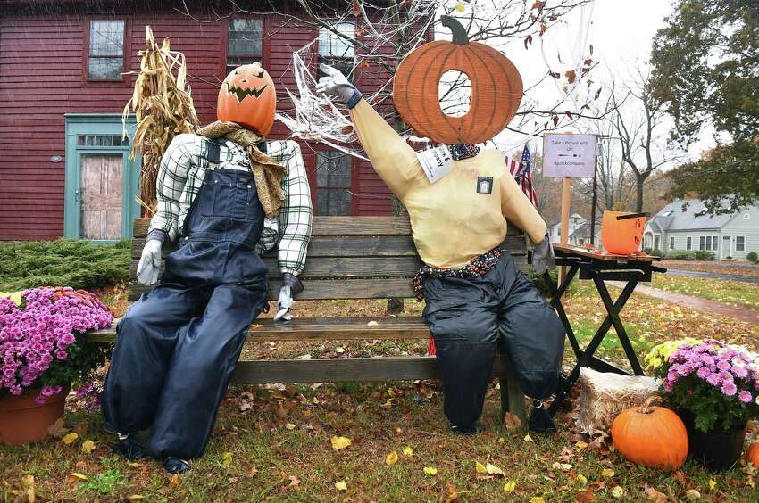 A Scarecrows Invade Madison contest entry in front of the Phineas Meigs House weathers a rain storm on October 27, 2019. The winner of the contest will be announced on October 31 at the Trunk or Treat event on the Madison Green.