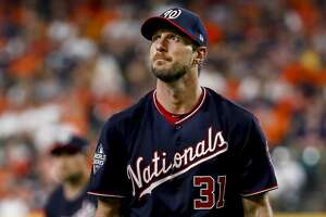 Washington Nationals starting pitcher Max Scherzer (31) walks back to the dugout after striking out Houston Astros first baseman Yuli Gurriel (10) to end the fifth inning of Game 1 of the World Series at Minute Maid Park in Houston on Tuesday, Oct. 22, 2019.