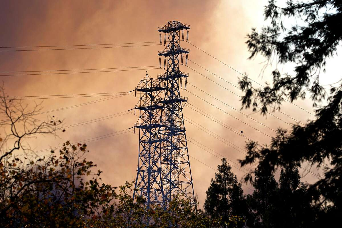 A fire burns near power lines from the Glen Cove neighborhood, over Interstate 80 and into the CSU California Maritime Academy campus in Vallejo on Sunday, Oct. 27, 2019.