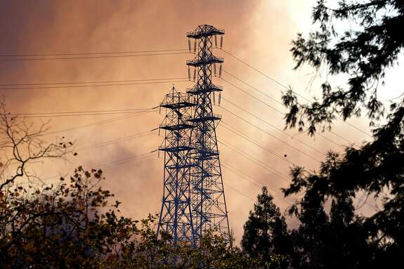A fire burns near power lines from the Glen Cove neighborhood, over Interstate 80 and into the CSU California Maritime Academy campus in Vallejo on Sunday, Oct. 27, 2019