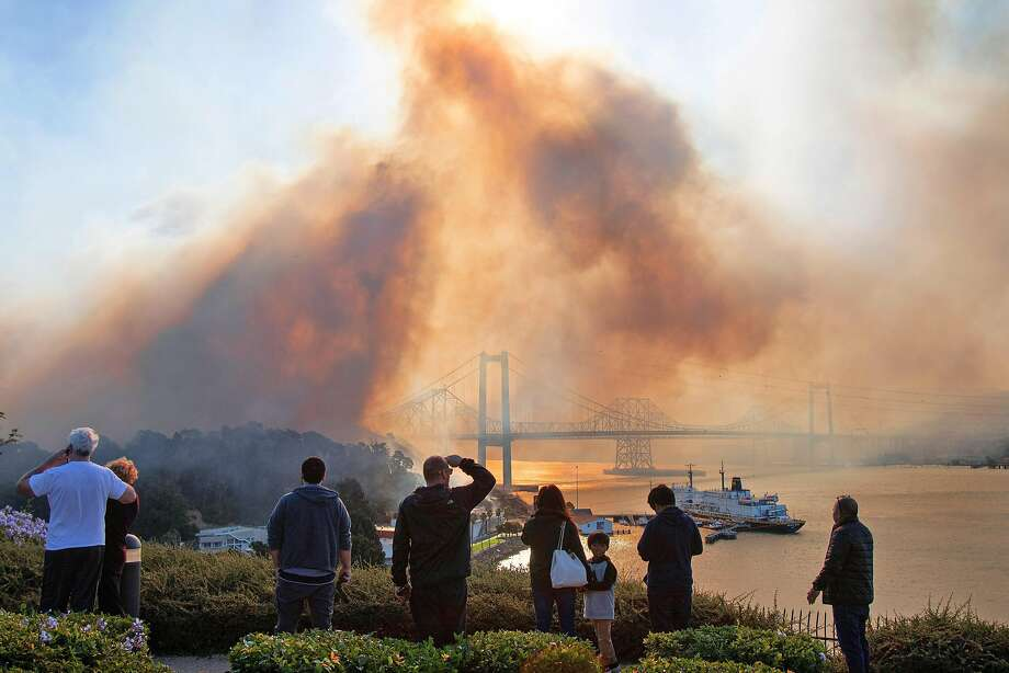 Residents watching the Vallejo Glen Cove fire on Sunday, Oct. 27, 2019. In our third straight year of wildfires and disaster, people are declaring yet again that California is broken beyond repair. Photo: Chris Preovolos / Chris Preovolos