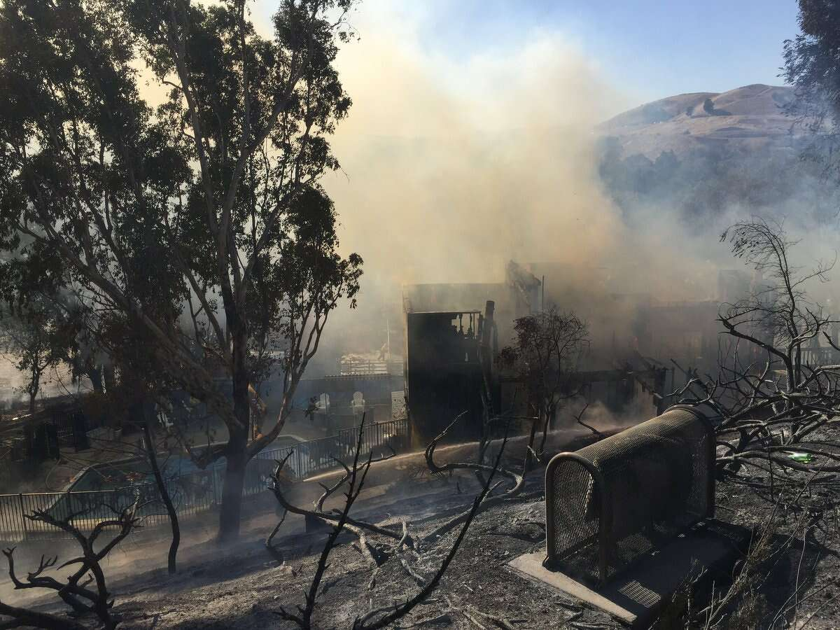 """The Lafayette Tennis Club building was a """"total loss,"""" according to the Contra Costa Fire Protection District."""