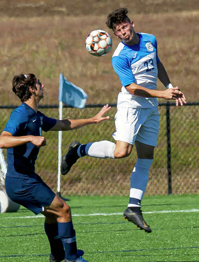 Will Grant of Lewis and Clark (3) goes high for a headball in front of Heartland College's Daniel Trojman during Sunday's Region 24 Tournament semifinal game at the Missouri Rush Soccer Complex in St. peters, Mo. Photo: Jan Dona | For The Telegraph