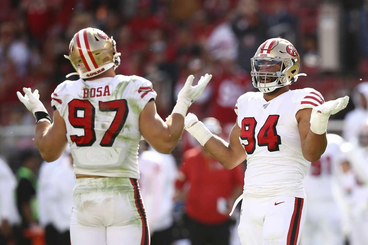 Nick Bosa #97 and Solomon Thomas #94 of the San Francisco 49ers react after sacking Kyle Allen #7 of the Carolina Panthers (not pictured) during the second quarter at Levi's Stadium on October 27, 2019 in Santa Clara, California.