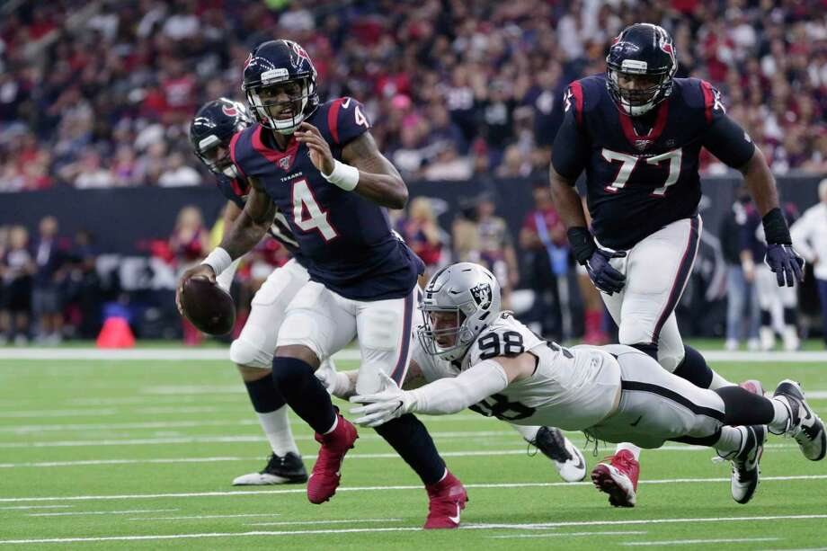 Houston Texans quarterback Deshaun Watson (4) is pressured by Oakland Raiders defensive end Maxx Crosby (98) as he looks to make a pass for a touchdown to tight end Darren Fells during the second half Sunday in Houston. Photo: Michael Wyke, FRE / Associated Press / Copyright 2019 The Associated Press. All rights reserved