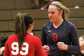 Staunton's Hollie Bekeske (99) and Taryn Russell talk before a serve in a match earlier this month at the Macoupin County Tourney in Carlinville. The 30-4 Bulldogs play this week at the Greenville Class 2A Regional.