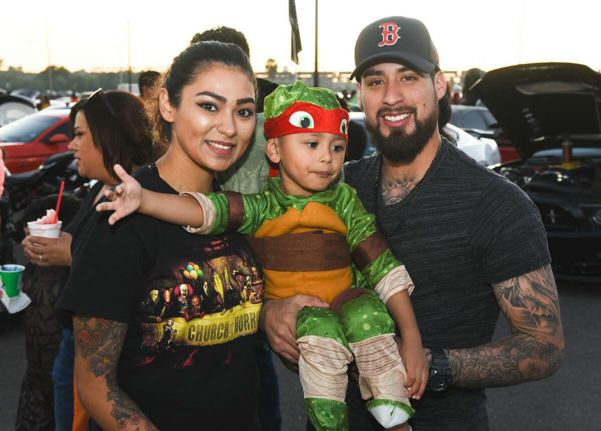 Families don their Halloween costumes as they collect treats on Saturday, Oct. 26, 2019, at the Outlet Shoppes at Laredo during it's 3rd Annual Trunk or Treat event.