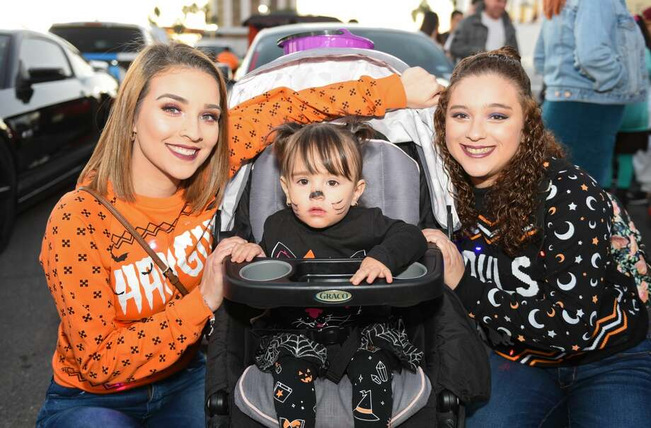 Families don their Halloween costumes as they collect treats on Saturday, Oct. 26, 2019, at the Outlet Shoppes at Laredo during it's 3rd Annual Trunk or Treat event. Photo: Danny Zaragoza