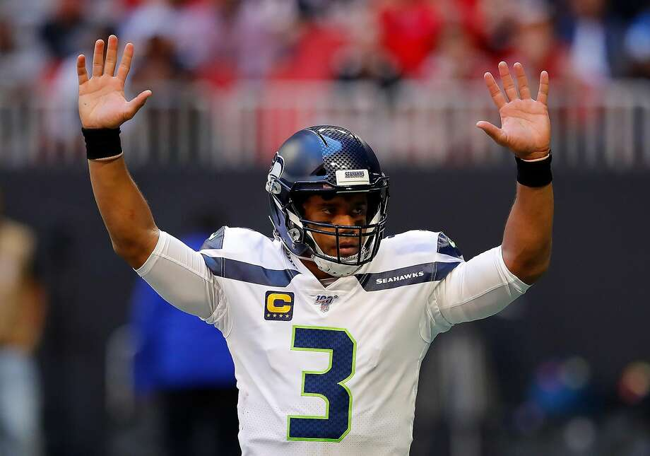 ATLANTA, GEORGIA - OCTOBER 27:  Russell Wilson #3 of the Seattle Seahawks reacts after passing for a touchdown in the first half against the Atlanta Falcons at Mercedes-Benz Stadium on October 27, 2019 in Atlanta, Georgia. (Photo by Kevin C. Cox/Getty Images) Photo: Kevin C. Cox / Getty Images