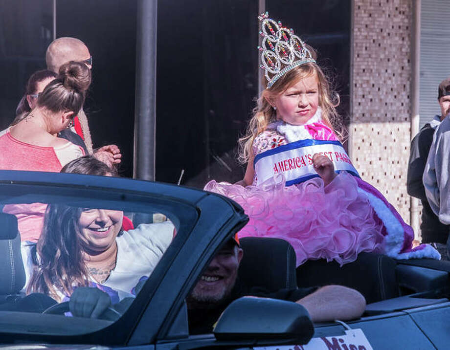 Tiny Miss Wood River Tatum Morckel reacts to something — perhaps spooky — in the crowd Sunday during Wood River's Halloween Parade. It was all part of the season's frightening fun. Seconds later, she was back to smiling and waving. Hundreds turned out for the annual event under near-perfect weather. It had been rescheduled due to Saturday's chilly downpour. Photo: Nathan Woodside | The Telegraph