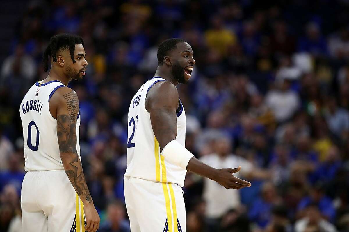 SAN FRANCISCO, CALIFORNIA - OCTOBER 24: Draymond Green #23 and D'Angelo Russell #0 of the Golden State Warriors react to a call during their game against the LA Clippers at Chase Center on October 24, 2019 in San Francisco, California. NOTE TO USER: User expressly acknowledges and agrees that, by downloading and or using this photograph, User is consenting to the terms and conditions of the Getty Images License Agreement. (Photo by Ezra Shaw/Getty Images)