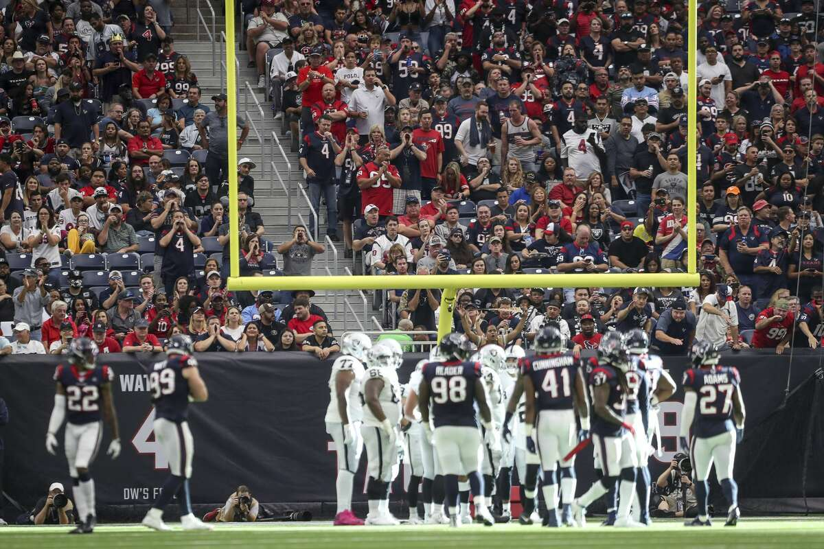 Fans react during the second quarter of an NFL football game at NRG Stadium on Sunday, Oct. 27, 2019, in Houston.
