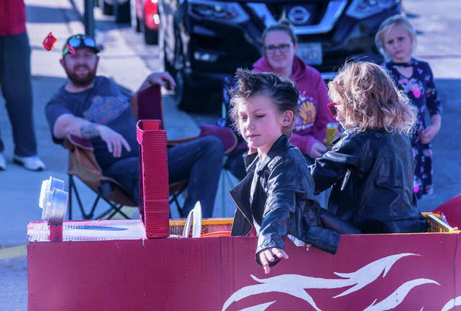 Two youngsters dressed as greasers cruise Hartford's Delmar Avenue in their custom hot rod Sunday during the village's annual Halloween parade. Photo: Nathan Woodside | The Telegraph