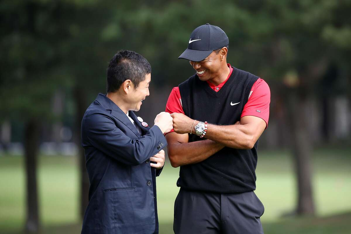INZAI, JAPAN - OCTOBER 28: Tiger Woods (R) of the United States is congratulated by the Zozo founder Yusaku Maezawa (L) at the award ceremony following the final round of the Zozo Championship at Accordia Golf Narashino Country Club on October 28, 2019 in Inzai, Chiba, Japan. (Photo by Chung Sung-Jun/Getty Images)