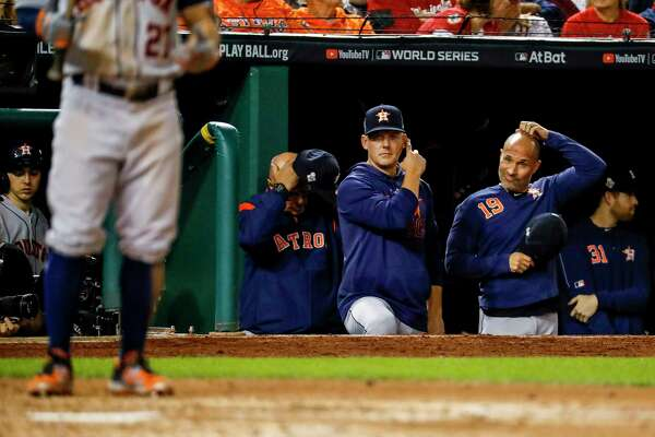 Houston Astros manager AJ Hinch (14) and Houston Astros bench coach Joe Espada (19) watch from the dugout during the fifth inning of Game 5 of the World Series at Nationals Park in Washington, D.C. on Sunday, Oct. 27, 2019.