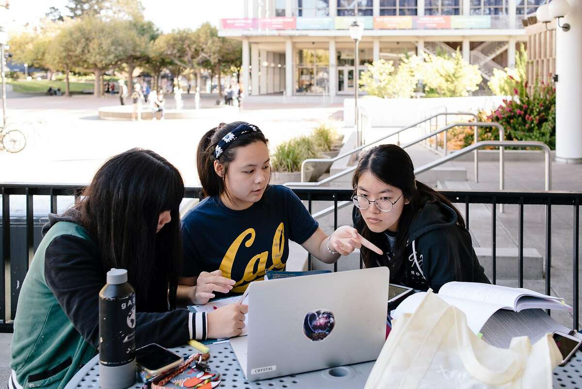 Freshman students Grace Li, left, Crystal Li, and Cindy Li study astronomy at a table outside the closed Golden Bear restaurant at UC Berkeley in Berkeley, California, on Friday, Oct. 9, 2019. UC Berkeley canceled classes and closed the school on Wednesday in the face of looming planned power shutoff's by PG&E.