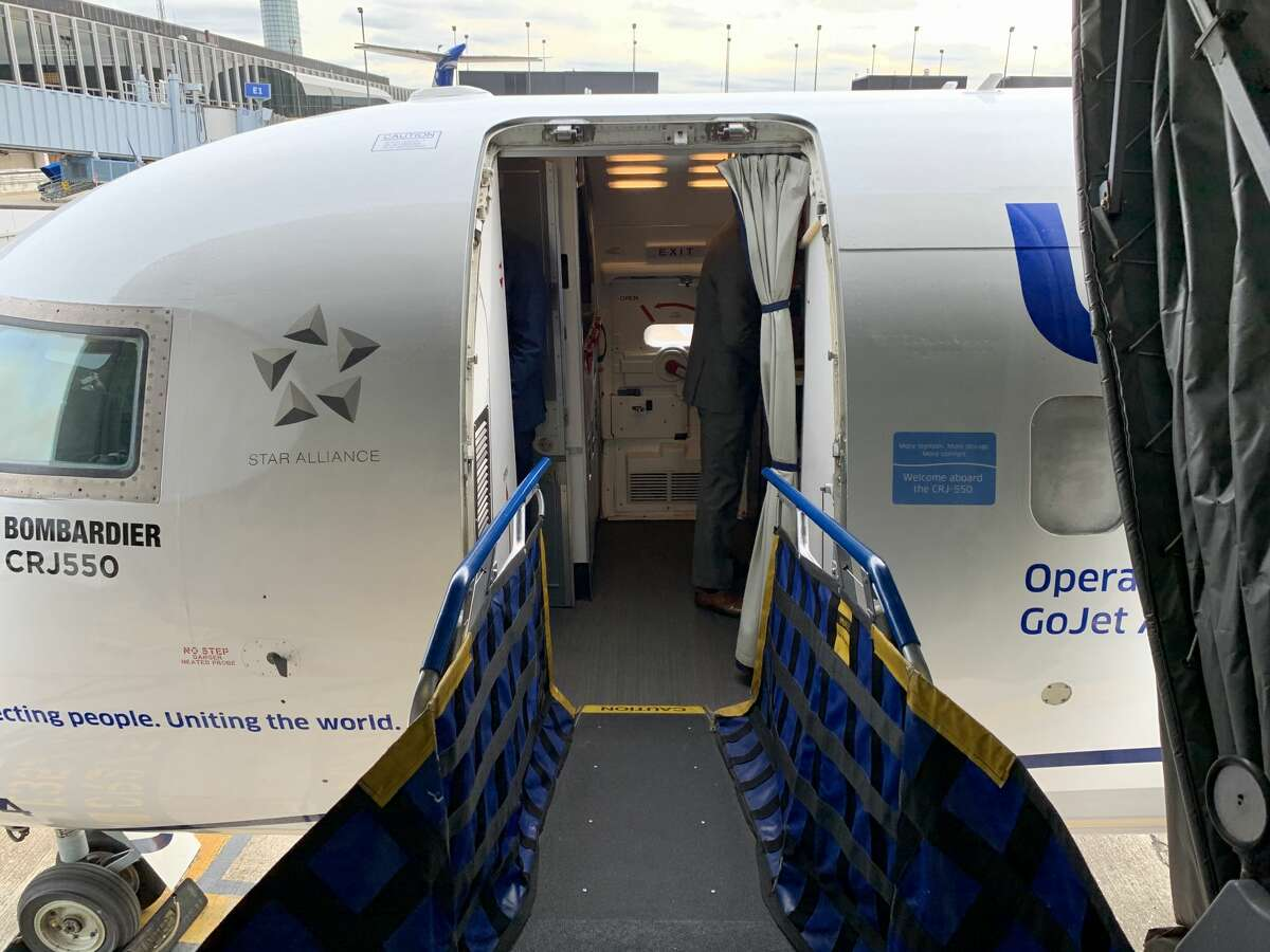 United is making sure people boarding the Bombardier CRJ-550 know what they're getting. Decals have been placed next to the entry way telling fliers about the added space.