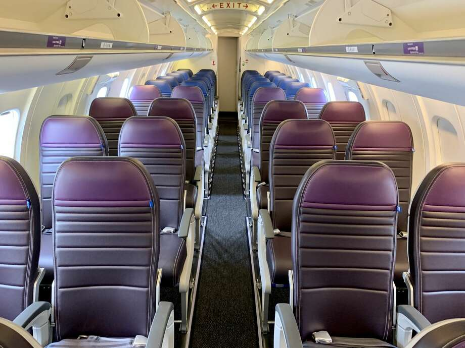 United has put purple seat covers on the extra legroom Economy Plus seats - a color now associated with its international premium economy product Premium Plus. SEE SLIDESHOW FOR MORE IMAGES!  Photo: Tim Jue