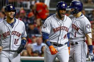 Houston Astros left fielder Yordan Alvarez (44) is welcomed home by Houston Astros shortstop Carlos Correa (1) and Houston Astros first baseman Yuli Gurriel (10) after Alvarez hit a two-run home run during the second inning of Game 5 of the World Series at Nationals Park in Washington, D.C. on Sunday, Oct. 27, 2019.