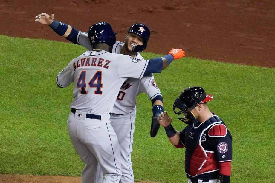 Houston Astros' Yordan Alvarez is congratulated by Yuli Gurriel after hitting a two-run home runn during the second inning of Game 5 of the baseball World Series against the Washington Nationals Sunday in Washington. Photo: Pablo Martinez Monsivais, STF / Associated Press / Copyright 2019 The Associated Press. All rights reserved.
