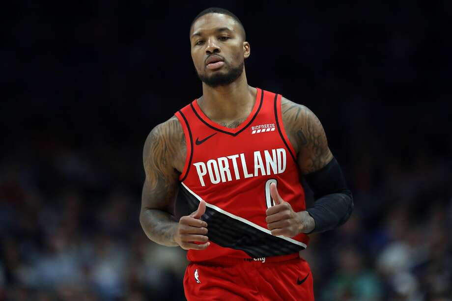 DALLAS, TEXAS - OCTOBER 27:  Damian Lillard #0 of the Portland Trail Blazers reacts during play against the Dallas Mavericks at American Airlines Center on October 27, 2019 in Dallas, Texas. NOTE TO USER: User expressly acknowledges and agrees that, by downloading and or using this photograph, User is consenting to the terms and conditions of the Getty Images License Agreement.  (Photo by Ronald Martinez/Getty Images) Photo: Ronald Martinez, Getty Images