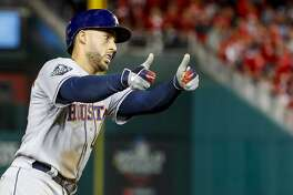 Houston Astros right fielder George Springer (4) rounds third base after hitting a two-run home run during the ninth inning of Game 5 of the World Series at Nationals Park in Washington, D.C. on Sunday, Oct. 27, 2019.