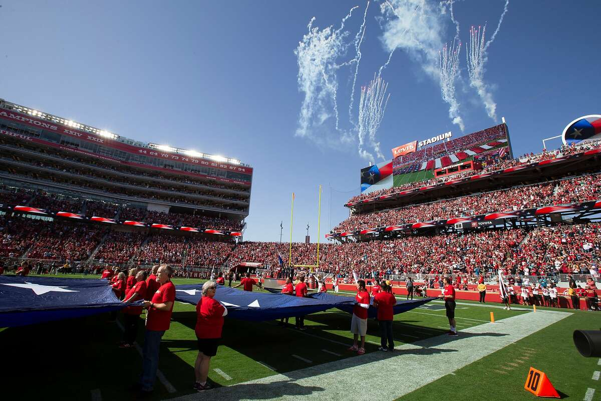 Fireworks explode over the scoreboard during the playing of the national anthem before an NFL football game between the San Francisco 49ers and Carolina Panthers, on Sunday, Oct. 27, 2019 in Santa Clara, Calif.