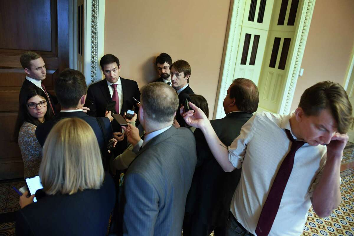 Sen. Marco Rubio, R-Fla. (center) talks to journalists at the U.S. Capitol in Washington on Oct. 22, 2019.