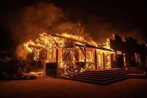 A structure burns at Soda Rock Vineyards in Healdsburg, Calif., on Oct. 27, 2019.