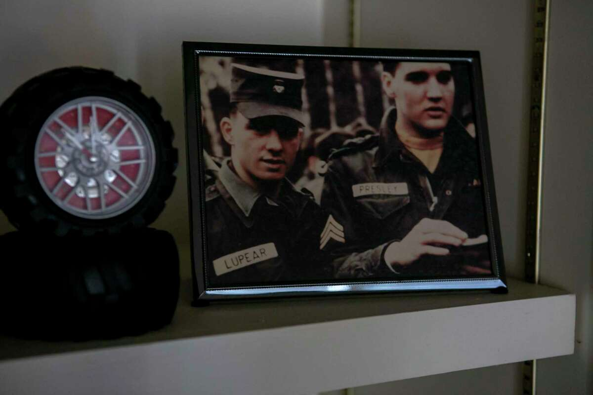 A framed photo of Larry Lupear and Elvis Presley sits on display in Lupear's San Antonio home on Oct. 3, 2019. Lupear met Elvis Presley in the Army when they both trained at Fort Hood and later were stationed in Germany in the same outfit.